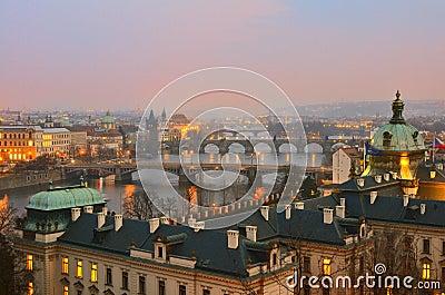 Sunset view on four Prague bridges