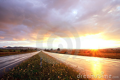 Sunset on wet road