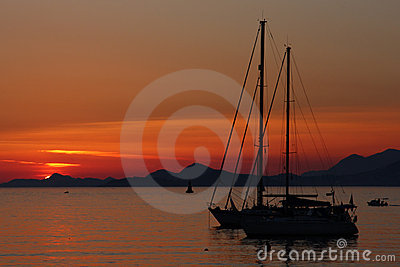 Sunset with yacht silhouette