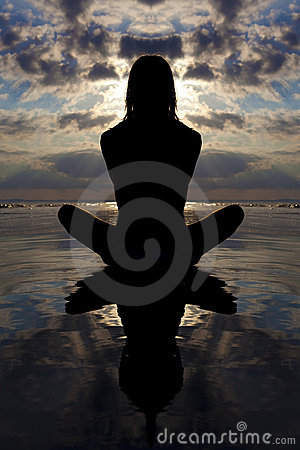 Sunset yoga pose with reflection in the water.