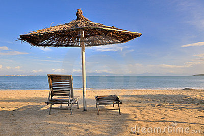 Sunshade and rest chair on sea sand