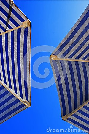Sunshades against the blue sky