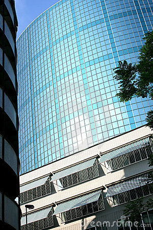 Sunshades and dutch glass building in sunlight