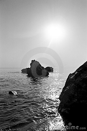 Sunshine over rocky coastline