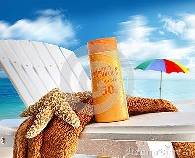 Suntan lotion on chair at the  beach