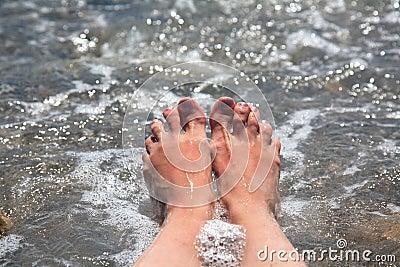 Suntanned female feet
