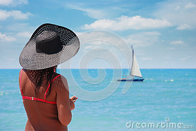 Suntanned woman on a beach