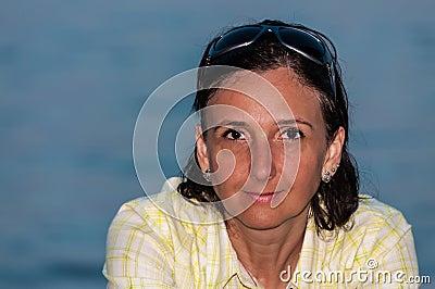 Suntanned woman portrait on beach