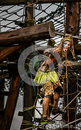 Free Super Hero Competitor 2014 Tough Guy Obstacle Race In Fancy Dress Hanging On Ropes Royalty Free Stock Images - 72263539