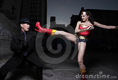 Superhero kicking the evil villain