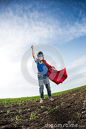 Free Superhero Kid Jumping Stock Photo - 31341890