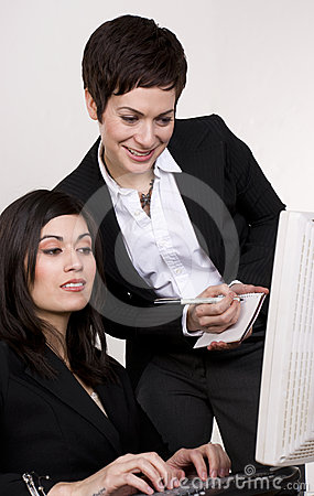 Supervisor Checks Computer Work Female Subordinate