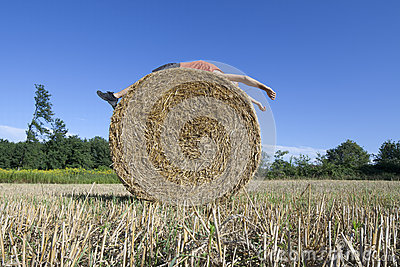 Supine man on Hay bale
