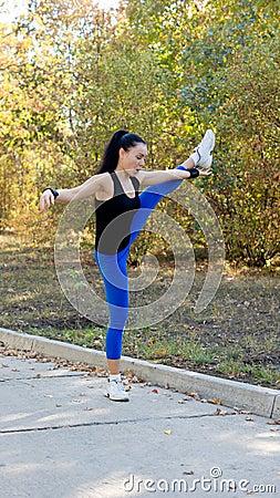Supple woman balancing on one leg