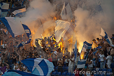 Supporters burn flares Editorial Photography