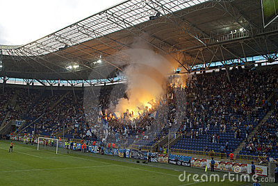 Supporters burn flares Editorial Stock Photo