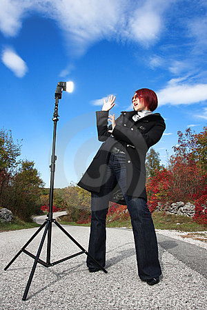 Suprised woman in front of flash light