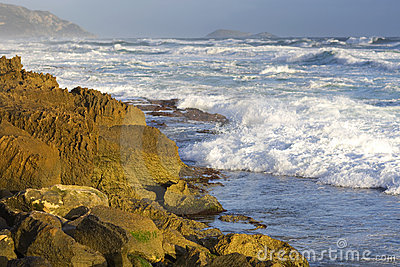 Surf along rocky coastline