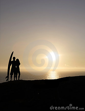Surf couple at sunset
