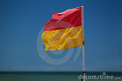 Surf lifesaving flag on beach.