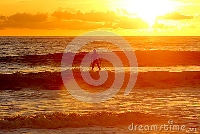 Surf like god - Standing on water sunset