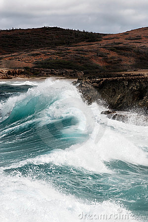 Surf pounding Aruba s rocky coast
