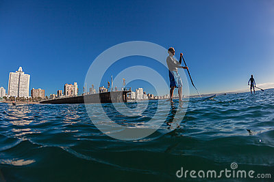 Surf Riders SUP Standing Morning Blue Editorial Photography