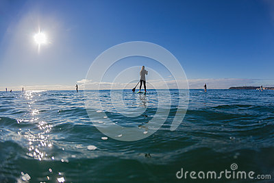 Surf Riders SUP Standing Waiting Waves Blue Editorial Photo