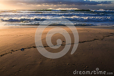 Surf, sand, and sunrise at the beach