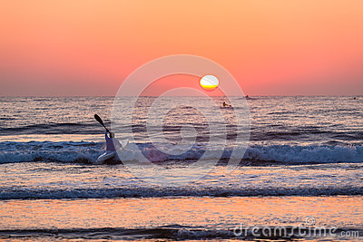 Surf-Ski Canoe Paddling Ocean Sunrise  Editorial Photo