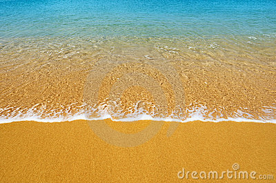 Surf on tropical beach - background