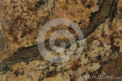 Surface of the granite. Reddish-brown shades.