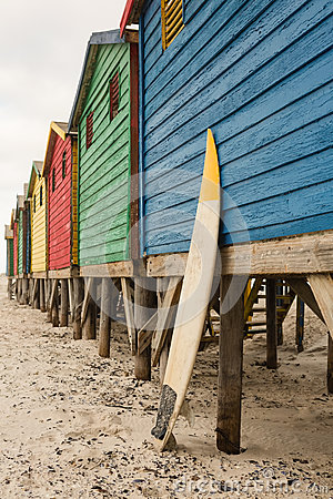 Free Surfboard By Blue Wooden Hut At Beach Royalty Free Stock Photos - 92565428