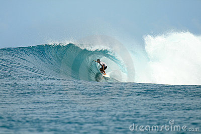 Surfer in barrel getting tube view, Indonesia