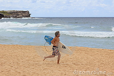 Surfer running at beach Editorial Image