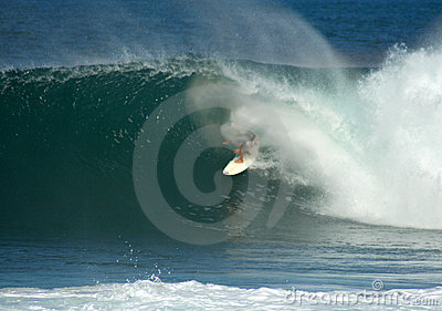 Surfer in a big barrel on the North Shore, Hawaii