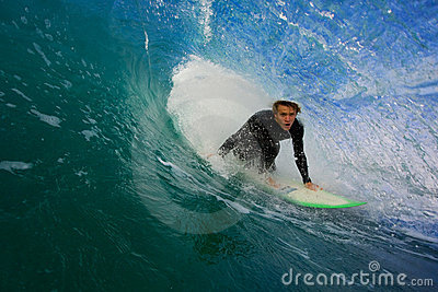 Surfer on Blue Wave in Tube