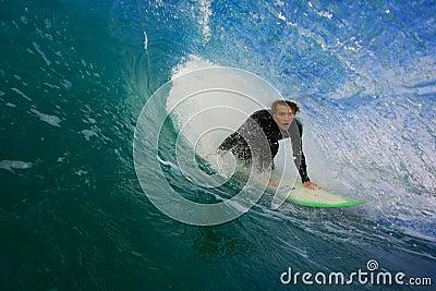 Surfer on Blue Wave in Tube