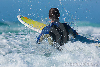 Surfer and board in sea with waves
