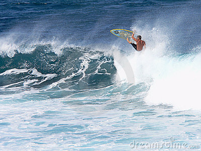A surfer catches air in Maui