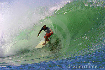 Surfer Clyde Lani Surfing a Tubing Wave Editorial Photo