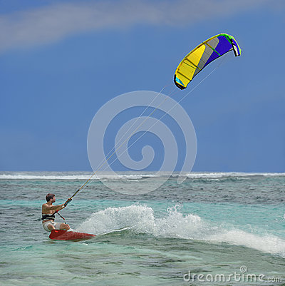 Surfer. Speed, splashes, colorful kite