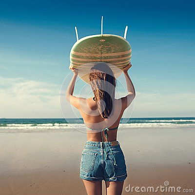 Free Surfer Girl Stock Image - 107241031