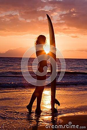 Surfer girl sunset