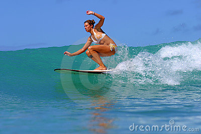 Surfer Girl Surfing a Wave in Hawaii Editorial Image