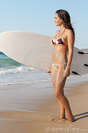 Free Surfer Girl With Her Surfboard Royalty Free Stock Photos - 67263348