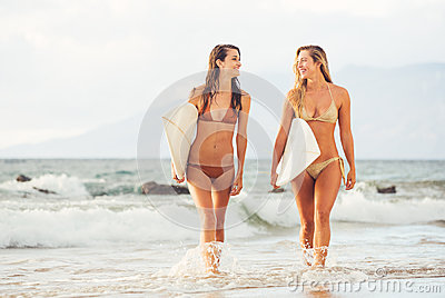 Surfer Girls on the Beach at Sunset in Hawaii