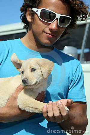 Free Surfer Guy And His Dog Royalty Free Stock Photography - 5456907