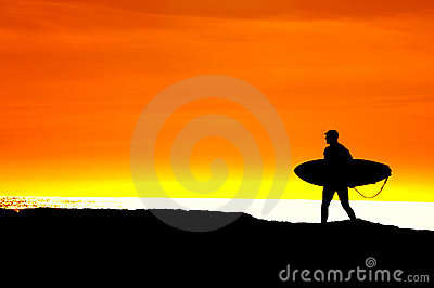 Surfer heading for a sunset ride
