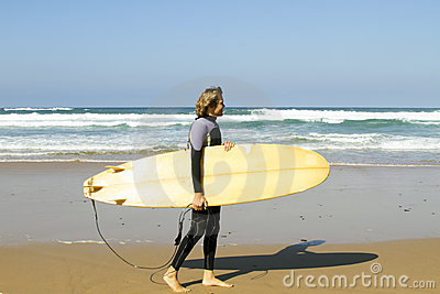 Surfer with his surfboard